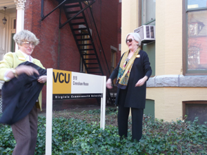 Crenshaw's granddaughters, Sally Clay Witt (left) and Anne Warfield Crenshaw Truesdale, pulled away a cover, revealing the building's renaming as Crenshaw House.