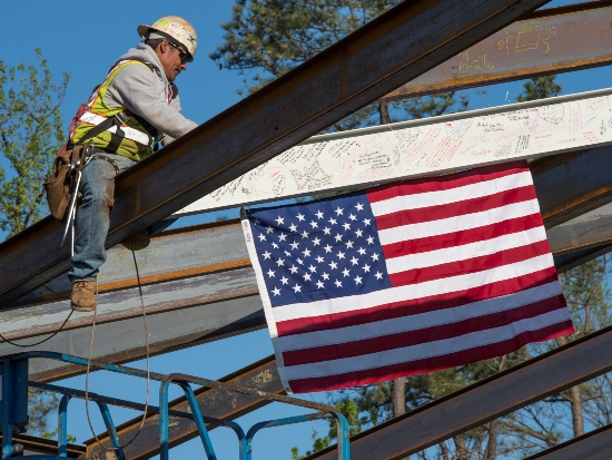 VTCC's final steel beam is raised into place, topping out the 120,000-square-foot pediatric mental health facility.